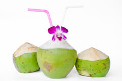 Green coconuts with drinking straw isolated Stock Photos