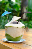 Green coconuts with drinking straw Stock Image
