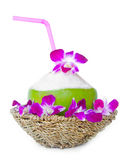 Green coconuts with drinking straw in weave basket Royalty Free Stock Photo