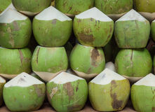 Green coconuts with juice inside. Street drinks in Thailand Royalty Free Stock Images