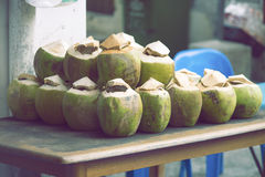 Green coconuts on table Royalty Free Stock Images