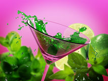Green coctail splash Royalty Free Stock Images