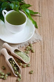 Green coffee background. Green coffee - beans and ground. Selective focus. Copy space background Stock Photography