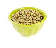 Green coffee beans in bowl Stock Image