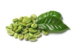 Green coffee beans and fresh leaves. On white background stock image