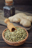 Green coffee beans and ginger Royalty Free Stock Images