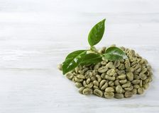 Green coffee beans. On a white background Royalty Free Stock Photos