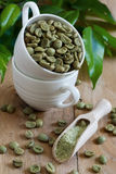 Green coffee. Beans and ground. Selective focus Stock Image