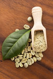 Green coffee beans with leaf Stock Photos