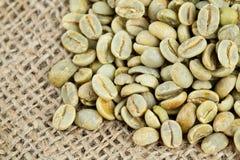 Green coffee beans on sack Royalty Free Stock Photos