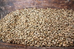 Green coffee beans. Green beans in a very old wooden bowl Stock Photography
