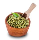 Green coffee beans in wooden bowl Royalty Free Stock Images