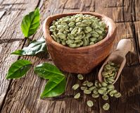 Green coffee beans in wooden bowl Royalty Free Stock Photo