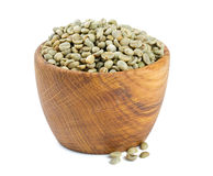 Green coffee beans in a wooden bowl Royalty Free Stock Images