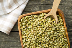 Green coffee beans in wooden bowl Royalty Free Stock Photos