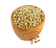 Green coffee beans in a wooden bowl Stock Image