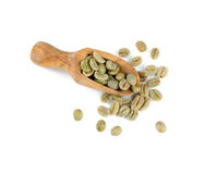 Green coffee beans in a wooden scoop Stock Image
