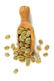 Green coffee beans in a wooden scoop Stock Images