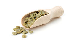 Green coffee beans in a wooden scoop Royalty Free Stock Photography