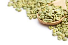 Green coffee beans in wooden spoon Royalty Free Stock Photography