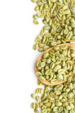Green coffee beans in wooden spoon Royalty Free Stock Photos