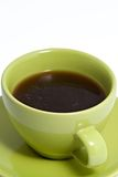 Green Coffee Cup Full of Coffee. Close up shot of a green coffee cup and saucer, containing black coffee stock image