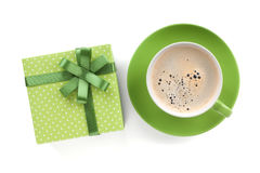 Green coffee cup and gift box with bow Stock Photos