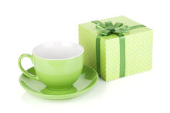 Green coffee cup and gift box with bow Royalty Free Stock Photo