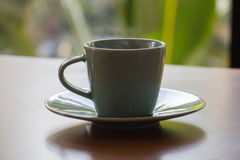 Green coffee cup. It is hot and has a smoke Stock Image