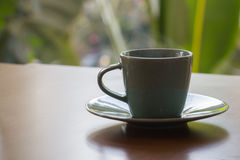 Green coffee cup. It is hot and has a smoke Stock Images