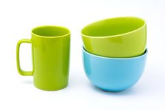 Green coffee cup and light blue bowl and green bowl. Isolated with white background. bowls over bowls., bowls pastel tone Stock Photo