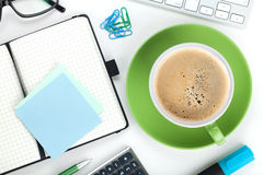 Green coffee cup and office supplies Royalty Free Stock Photography
