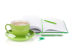 Green coffee cup and office supplies Royalty Free Stock Images