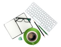 Green coffee cup and office supplies Stock Image
