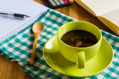 Green coffee cup with office supplies Royalty Free Stock Images