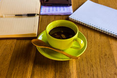 Green coffee cup with office supplies Stock Images