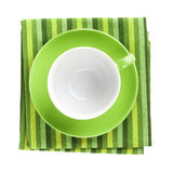 Green coffee cup over kitchen towel royalty free stock image