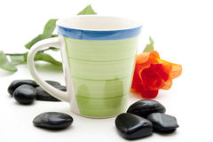 Green coffee cup with red rose Stock Photography