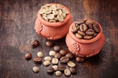 Green coffee; roasted coffee beans. Royalty Free Stock Image