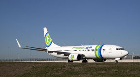 Green is the color of this airliner. Stock Images