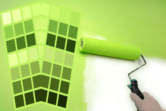 Green color chart. Complimentary green color chart and hand painting wall royalty free stock images
