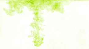Green color dissolving in water Stock Photo