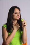 GREEN color. eating  lime macaron Royalty Free Stock Photography