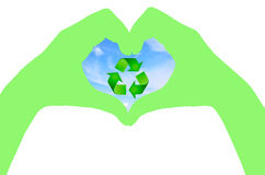 Green color Hand and recycle sign with blue sky. On white background Royalty Free Stock Photo