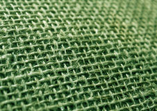 Green color hessian cloth sack texture with blur effect. Stock Photos