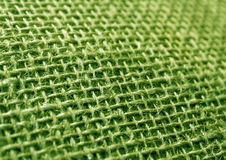 Green color hessian cloth sack texture with blur effect. Royalty Free Stock Images