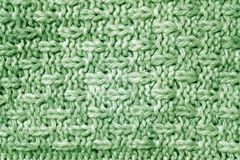 Green color knitted pattern. Abstract background and texture Stock Photos