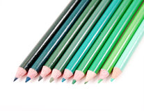 Green Color Pencils. Row of spectrum of green color pencils on a white background Royalty Free Stock Image