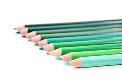 Green Color Pencils. Row of spectrum of green color pencils on a white background stock photo