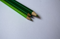 Green color pencils and white paper Stock Photography
